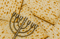 Menorah in front of Matzot Royalty Free Stock Image