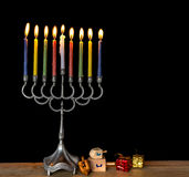 Menorah with glitter light of candles and dreidels Royalty Free Stock Photos