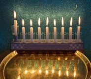 Menorah with glitter light of candles is a traditional symbol for Hanukkah holiday Stock Photo