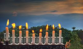 Menorah with glitter lights of candles Stock Image