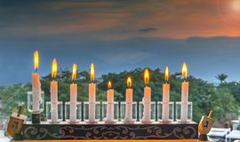 Menorah with glitter lights of candles Stock Photos