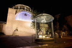 Menorah - the golden seven-barrel lamp - the national and religious Jewish emblem near the Dung Gates on the background of the stock photography