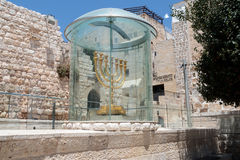 The Menorah - the golden seven-barrel lamp - the national and religious Jewish emblem near the Dung Gates in the Old City of Jerus Stock Images