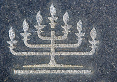 Menorah on granite tombstone Stock Image