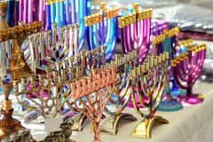 Menorah of Hanukkah traditional candelabra at the stand of souvenir and present gift shop, Netanya, Israel. royalty free stock image