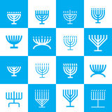 Menorah icons pattern. Menorah shape pattern in blue and white. 16 menorah shapes in one pattern Stock Photos
