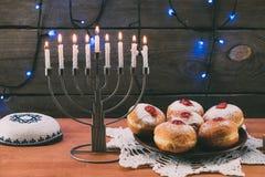 Menorah, Kippah and donuts for hanukkah. Traditional jewish menorah, Kippah and donuts for hanukkah celebration Stock Photos