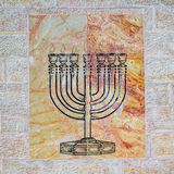 Marble plate with typical menorah Royalty Free Stock Image