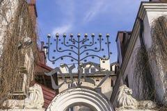 Menorah over  entrance. Ornament above the entrance to the building in the Jewish quarter, Szeroka Street in Krakow. Poland Stock Photo