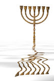 Menorah reflected on water Royalty Free Stock Photo