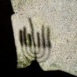 Menorah shadow on old wall.  Hanukkah candelabrum. Stock Images