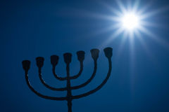 Menorah and the star. Silhouette of traditional jewish lightstand called menorah. Symbol of winter light festival called Hanuka (Hanukka, Chanukkah Royalty Free Stock Images
