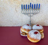 Menorah and sweet donuts are Hanukkah Jewish holiday symbols Stock Photography