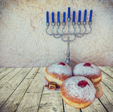 Menorah and sweet donuts are Hanukkah Jewish holiday symbols Stock Images