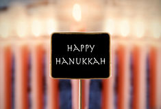 Menorah and text happy Hanukkah in a chalkboard Stock Images