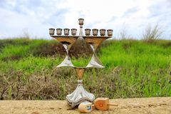 Menorah and wooden Dreidels of Jewish holiday Hanukkah stock photography