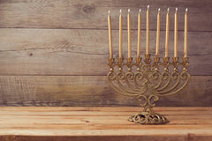 Menorah on wooden table, Hanukkah celebration Royalty Free Stock Photo