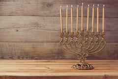 Menorah on wooden table, Hanukkah celebration. Menorah on wooden table, a Jewish Hanukkah celebration