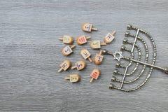 Menorah on wooden table. Hanukkah symbol. Stock Images