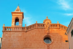 Menorca, Balearic Islands, Spain, bell tower, El Roser, church, Ciutadella. The bell tower of El Roser Church seen through the window of an antique shop in Royalty Free Stock Images