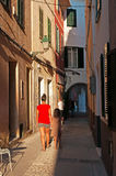 Menorca, Balearic Islands, Spain. Local people in the streets of Ciutadella on July 7, 2013. Ciutadella is the former capital city of Menorca, in the western end Royalty Free Stock Photography