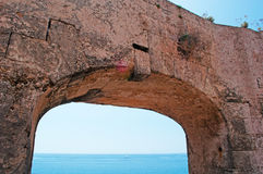 Menorca, Balearic Islands, Spain, fort, fortress, military, La Mola, Mahon, architecture, stone. Mediterranean Sea trough an arch of the Fortress of Isabel II on Stock Photos