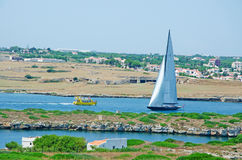 Menorca, Balearic Islands, Spain. A sailboat in the port of Mahon seen from the Fortress of La Mola on July 11, 2013. Mahon, the capital city of Menorca has one Stock Photo