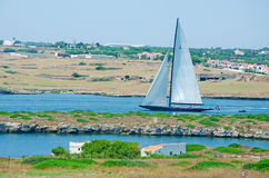Menorca, Balearic Islands, Spain, Mahon, port, sailing, sailboat, nature, landscape. A sailboat in the port of Mahon seen from the Fortress of La Mola on July 11 Royalty Free Stock Photography