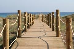 Menorca Beach. Wooden walkway down to Som Bou beach Menorca Royalty Free Stock Photography