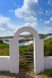 Menorca Cala Sa Mesquida Mao Maon arch entrance Royalty Free Stock Image