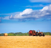 Menorca combine tractor wheat with round bales Royalty Free Stock Photography