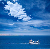 Menorca Son Saura beach in Ciutadella turquoise Balearic. Menorca Son Saura beach in Ciutadella boat sailing at Balearic islands Stock Image