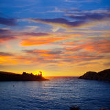 Menorca sunset in Cala Morell at Ses torretes beach Royalty Free Stock Photo