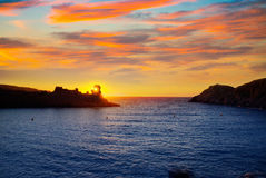 Menorca sunset in Cala Morell at Ses torretes beach Royalty Free Stock Photography