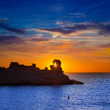 Menorca sunset in Cala Morell at Ses torretes beach Stock Image
