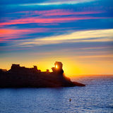 Menorca sunset in Cala Morell at Ses torretes beach Stock Photos