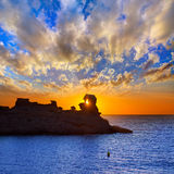 Menorca sunset in Cala Morell at Ses torretes beach Stock Images