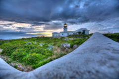 Menorca sunset at Faro de Caballeria Lighthouse Stock Image
