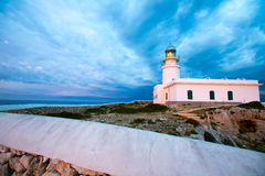 Menorca sunset at Faro de Caballeria Lighthouse Stock Photography