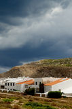Menorca Urbanization. Classic Houses in Small Menorca Urbanization between Hills under Cloudy Skies Outdoors. Balearic Islands Stock Photos