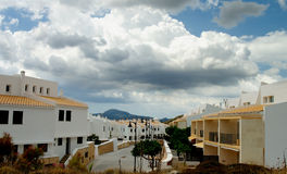 Menorca Urbanization. Classic Small Menorca Urbanization with White Houses under Cloudy Skies Outdoors. Balearic Islands Stock Photography