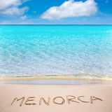 Menorca word written on sand of mediterranean beach Stock Photos