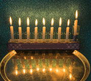 Menorha for Hanukkah holiday. Menorah with burning candles is a traditional Jewish attribute for Hanukkah holiday. Image slightly toned for retro style Stock Photography