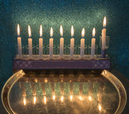 Menorha for Hanukkah holiday. Menorah with burning candles is a traditional Jewish attribute for Hanukkah holiday. Image slightly toned for retro style Royalty Free Stock Photo