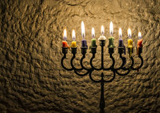 Menorha for Hanukkah holiday. Menorah with burning candles is a traditional Jewish attribute for Hanukkah holiday. Image slightly toned for retro style Stock Images