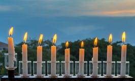 Menoror med blänker ljus av stearinljus Fotografering för Bildbyråer