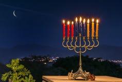 Menoror med blänker ljus av stearinljus Royaltyfria Bilder
