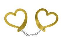 Menottes d'or de l'amour d'isolement sur le blanc Photographie stock libre de droits