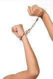menottes retenant le femme blanc d'isolement Image stock