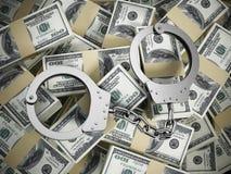 Menottes sur la pile d'argent des 100 dollars Photos libres de droits
